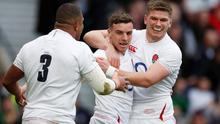 England's George Ford celebrates scoring their first try with Owen Farrell