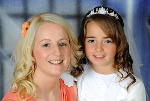 Zoe Scannell (8) in her communion dress, and with her mum Alisha Scannell, both of Bogmount, Abbeyfeale, Co Limerick.  Zoe died in a car crash yesterday (Thur) near Clonakilty, Cork, and her mum is in a critical condition in Cork University Hospital.  June 27, 2014