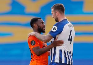 Newcastle United's Danny Rose with Brighton & Hove Albion's Shane Duffy after the match