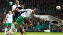Scotland's Steven Fletcher (C) is challenged by Ireland's Richard Keogh (front) and John O'Shea during their Euro 2016 Group D qualifying soccer match at Celtic Park