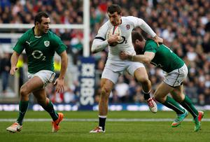 England's Jonny May is tackled by Ireland's Gordon D'Arcy during the RBS 6 Nations match at Twickenham Stadium