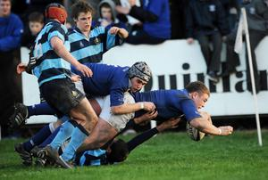 Jack McGrath of St Mary's, helped by team-mate William Andreucetti, goes over to score one of his side's tries in the first round of the 2008 Leinster Schools Senior Cup against Castleknock College at Lakelands Park. Photo: Stephen McCarthy / SPORTSFILE