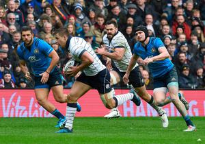 Scotland's Huw Jones makes a break chased by Italy's Carlo Canna with Dunbar of Scotland up in support. Photo: Ian Rutherford/PA Wire
