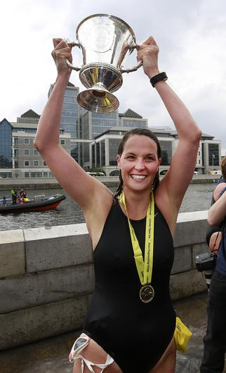 3/8/2019, Sinead Delaney, from Dunboyne, co. Meath celebrates after coming in first place in the ladies section of the Liffey swim in Dublin. Picture credit; Damien Eagers / INM