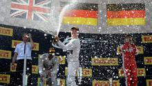 Mercedes AMG Petronas F1 Team's German driver Nico Rosberg sprays champagne on the podium after the Spanish Formula One Grand Prix yesterday at the Circuit de Catalunya in Montmelo on the outskirts of Barcelona (Getty Images)