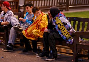"Supporters from the ""Yes"" Campaign react as they sit in George Square in Glasgow, Scotland September 19, 2014."