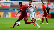 William Carvalho (L) of Portugal and Emre Can of Germany battle for the ball during the UEFA European Under-21 semi final match Between Portugal and Germany at Ander Stadium