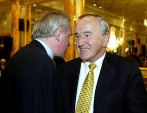 Taoiseach Bertie Ahern  chats with former Taoiseach Albert Reynolds  at the presentation of  the 2002 European of the Year Award.