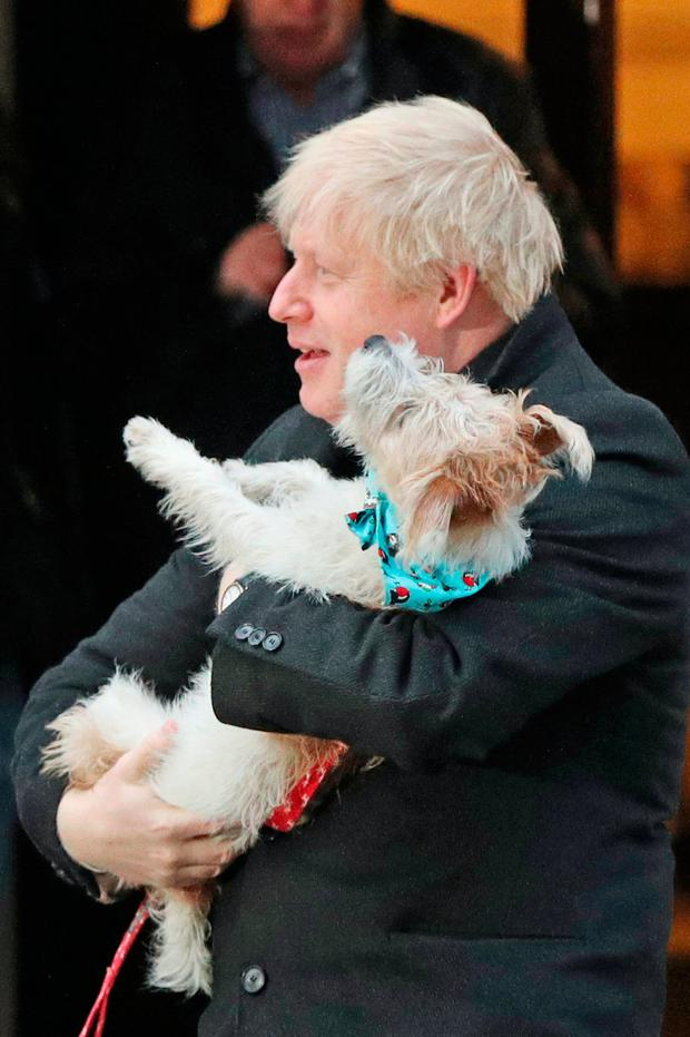 Prime Minister Boris Johnson holds his dog, Dilyn, after casting his vote in the 2019 General Election at Methodist Central Hall, London. Jonathan Brady/PA Wire