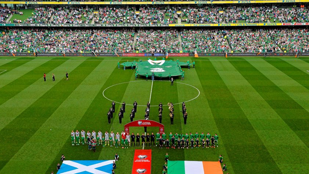 The two teams stand for the national anthems at the Aviva Stadium, Lansdowne Road, Dublin.