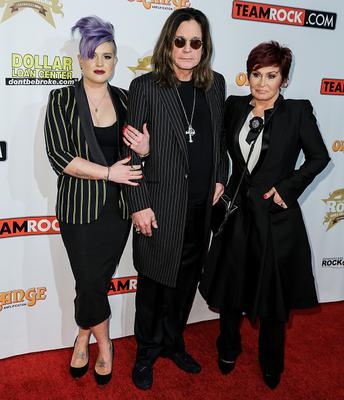 HOLLYWOOD, CA - NOVEMBER 04:  (L-R) Kelly Osbourne, musician Ozzy Osbourne and Sharon Osbourne attend the Classic Rock And Roll Honour 2014 Award Ceremony at Avalon on November 4, 2014 in Hollywood, California.  (Photo by Chelsea Lauren/WireImage)