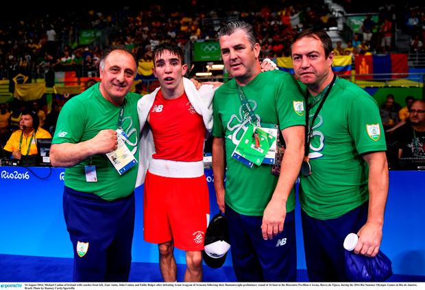 Michael Conlan of Ireland with coaches from left, Zaur Antia, John Conlan and Eddie Bolger after defeating Aram Avagyan of Armenia following their Bantamweight preliminary round of 16 bout in the Riocentro Pavillion 6 Arena, Barra da Tijuca, during the 2016 Rio Summer Olympic Games in Rio de Janeiro, Brazil. Photo by Ramsey Cardy/Sportsfile