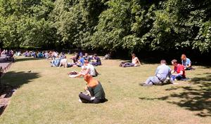 People enjoying the good weather in Stephens Green,Dublin. Photo: Gareth Chaney Collins