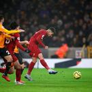 Liverpool's Roberto Firmino shoots to score the winner in the Premier League clash with Wolves at Molineux. Photo: Nick Potts/PA Wire