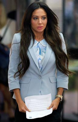 Former N-Dubz singer Tulisa Contostavlos arrives to give a statement outside Southwark Crown Court after her trial over drugs allegations has collapsed. PA