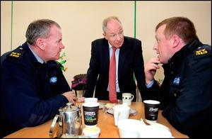 Minister of State for Regional Economic Development Michael Ring chats with Garda Kevin Conroy and Garda Tommy Organ from Belmullet Garda Station after he paid a visit to Aughleam Community Hall near Blacksod in Co Mayo during the seach and recovery of Rescue 116. Pic Steve Humphreys