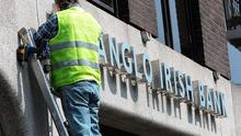 A workman removes the Anglo Irish Bank sign from outside the bank's headquarters in St Stephens Green. Photo: Damien Eagers