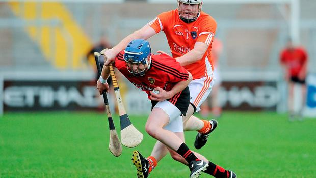 Eoin McGuinness puts pressure on Down's Danny Toner