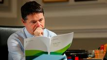 Study: Finance Minister Paschal Donohoe reviews the final figures for Budget 2019 in his office in the Department of Finance. Photo: Gerry Mooney