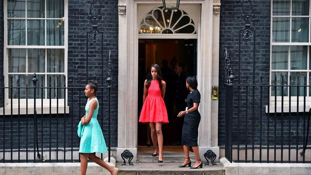 LONDON, ENGLAND - JUNE 16:  Malia (C) and Sasha Obama (L) leave Downing Street following a meeting with Prime Minister David Cameron and his wife Samantha Cameron on June 16, 2015 in London,England  (Photo by Jeff J Mitchell/Getty Images)
