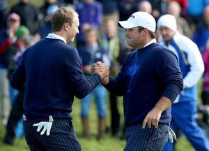 Jordan Spieth (L) and Patrick Reed of the United States celebrate victory on the 14th green during the Morning Fourballs of the 2014 Ryder Cup