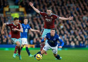 Everton's Ross Barkley and West Ham United's Kevin Nolan (centre) battle for the ball. Photo credit: Peter Byrne/PA Wire