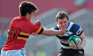 Nevil O'Sullivan, Crescent College Comprehensive, is tackled by Eoin Monahan, CBC