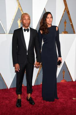 Pharrell Williams (L) and Helen Lasichanh attend the 88th Annual Academy Awards at Hollywood & Highland Center on February 28, 2016 in Hollywood, California.  (Photo by Ethan Miller/Getty Images)
