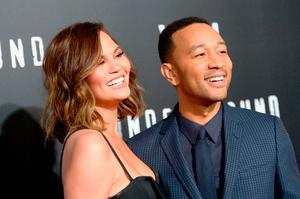 "Model Chrissy Teigen (L) and actor/singer/executive producer John Legend attend WGN America's ""Underground"" Season Two Premiere Screening at Regency Village Theatre on March 1, 2017 in Westwood, California.  (Photo by Charley Gallay/Getty Images for WGN America)"