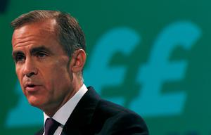 Bank of England Governor Mark Carney delivers his keynote speech at the annual Trades Union Congress, in Liverpool. Mr Carney has warned the Bank of England may start to raise interest rates next spring (REUTERS/Phil Noble)