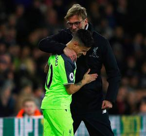 Jurgen Klopp hugs Philippe Coutinho, who is set to extend his Liverpool contract. Photo: Ian Walton/Getty Images