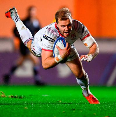 Will Addison dives over to score Ulster's third try during the match against Scarlets. Photo: Ramsey Cardy/Sportsfile