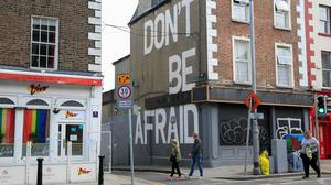 Members of the public pass a mural in Portobello, Dublin during the  Covid-19 (Coronavirus) pandemic in Ireland. Photo: Gareth Chaney/Collins