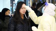 Passengers from China wearing masks to prevent a new coronavirus are checked by Saudi Health Ministry employees upon their arrival at King Khalid International Airport, in Riyadh, yesterday. Photo: Ahmed Yosri/Reuters