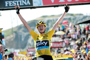 Chris Froome celebrates as he crosses the finish line to win the tenth stage of the Tour de France