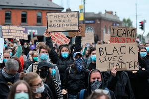 People take part in a Black Lives Matter protest rally outside the US embassy in Dublin Photo credit: Brian Lawless/PA Wire