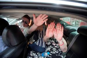 Michaella McCollum Connolly hiding in a back of taxi with her family after running down side streets from photographers. Pic:Mark Condren