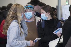Taking precautions: Travellers wear protective masks at Dublin Airport yesterday. Photo: Colin Keegan, Collins Dublin