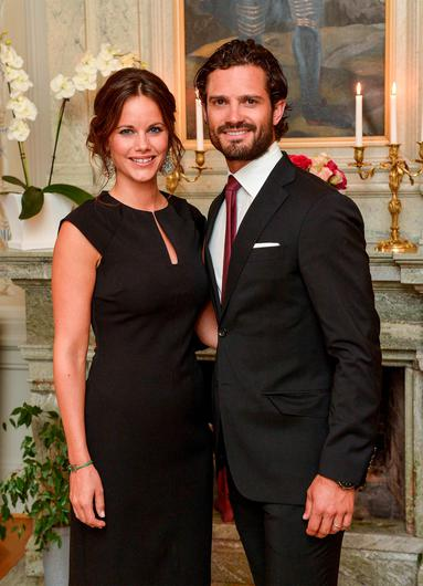 Picture taken on August 26, 2015 shows Sweden's Prince Carl Philip and Princess Sofia in Karlstad, Sweden. Sweden's Prince Carl Philip and his wife Princess Sofia, a former reality show starlet, are expecting their first child in April