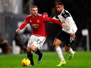 Manchester United's Luke Shaw and Fulhams Ruben Loftus-Cheek battle for the ball. Photo: PA