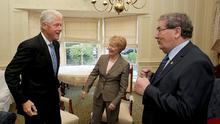 Man of influence: John Hume and his wife, Pat, greet former US president Bill Clinton at the Beech Hill Hotel, Derry, in 2010. Photo: REUTERS/Paul Faith/Pool/File Photo