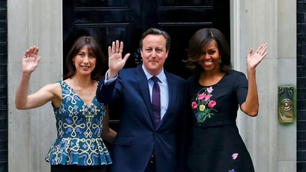 U.S. first lady Michelle Obama (R) poses with Britain's Prime Minister David Cameron and his wife Samantha at Number 10 Downing Street in London June 16, 2015. REUTERS/Darren Staples