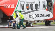 One of the two women rescued in Galway Bay wave as they  taken off the Coast Guard helicopter at UCHG. Photograph by Aengus McMahon