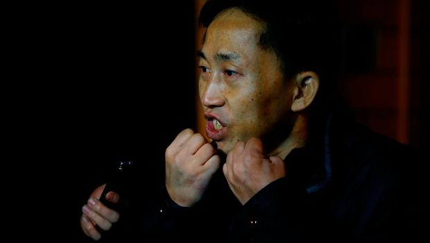 North Korean national Ri Jong Chol speaks to the media from behind the fence of the North Korean embassy compound in Beijing, China, March 4, 2017. REUTERS/Thomas Peter