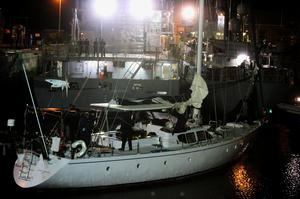 Customs officials aboard the yacht Makayabella in Haulbowline naval base, Cobh, Co Cork after the Irish Navy intercepted the vessel suspected of carrying around €80 million worth of cocaine 200 nautical miles off Mizen Head, Ireland's most southerly point - in the early hours of yesterday morning. Photo: PA Wire