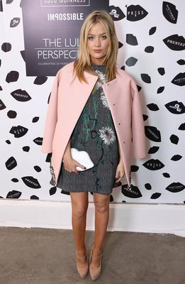 At the launch of The Lulu Perspective To Celebrate 25 Years of Lulu Guinness, she wore a bang-on-trend dusty pink cape style coat and printed dress
