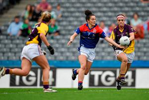 New York's Ciara Scally in action against Wexford's Catriona McCabe. Brendan Moran / SPORTSFILE