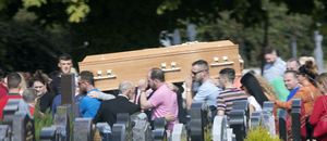 Mourners carry the coffin of Keith Branigan