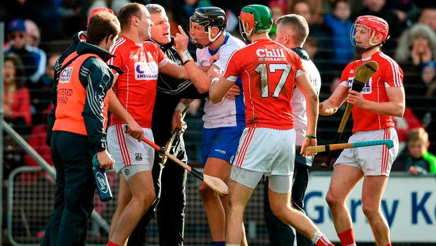 Waterford's Maurice Shanahan reacts in the direction of Cork's Dean Brosnan after being sent off by referee Barry Kelly. Photo: Stephen McCarthy/Sportsfile
