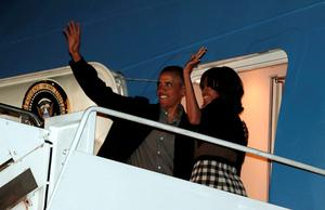 U.S. President Barack Obama and first lady Michelle Obama wave as they depart Joint Base Andrews in Washington June 16, 2013.  The Obamas are traveling to Northern Ireland where President Obama will attend the G8 summit